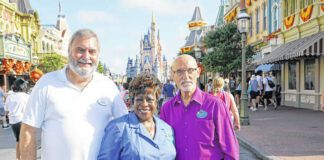 Walt Disney World employees from left, Chuck Milam, Earliene Anderson and Forrest Bahruth gather at the Magic Kingdom in Lake Buena Vista, Fla. to celebrate their 50 years working at the park.                                  AP photo