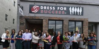 Officials cut a ribbon outside the refurbished Dress for Success shop on Market Street in Wilkes-Barre in this file photo.                                  Times Leader file photo