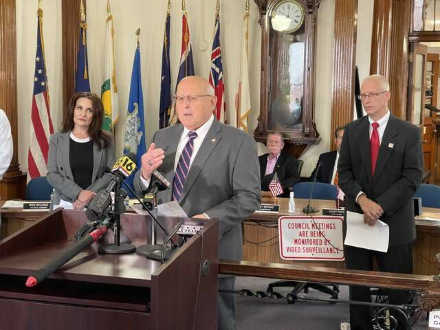 Wilkes-Barre Mayor George Brown Wednesday announced plans to disburse more tan $7 million in funding from the American Rescue Plan to help city non-profit organizations, new businesses and residents. Looking on are Community Development Director Joyce Zaykowski, left, and United Way of Wyoming Valley President/CEO Bill Jones.                                  Bill O'Boyle   Times Leader