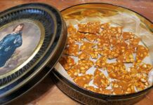 Home made peanut brittle broken into smaller bits and set on wax paper in a tin, ready for a trip to the newsroom for taste-testing by our bank of fellow ink-stained wretches. It garnered nothing but rave reviews.                                  Mark Guydish | Times Leader