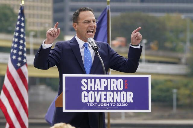 Pennsylvania's Democratic attorney general Josh Shapiro speaks to a crowd with Point State Park behind him across the Allegheny River during his campaign launch address for Pennsylvania governor, Wednesday in Pittsburgh. Keith Srakocic | AP photo