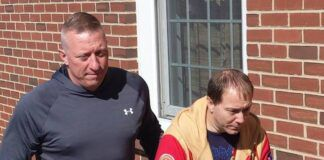 Kingston police Det. Edward Palka escorts George E. Fies Jr., a corrections officer in Lebanon County, to his arraignment on charges of sexual assault and unlawful contact with minors.                                  Ed Lewis | Times Leader