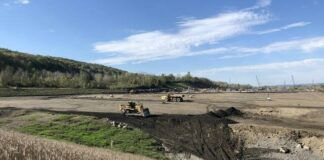 Heavy equipment prepares the site spanning Hanover Township, Nanticoke and Newport Township for NorthPoint Development's two new distribution centers.                                   Jerry Lynott | Times Leader